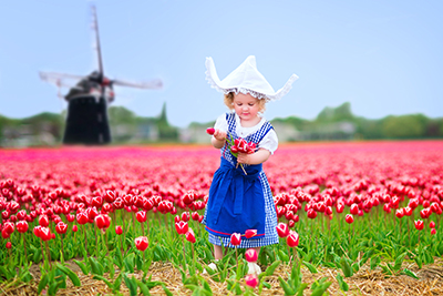 Young girl in with classic clothers in Holland Tulip Fields